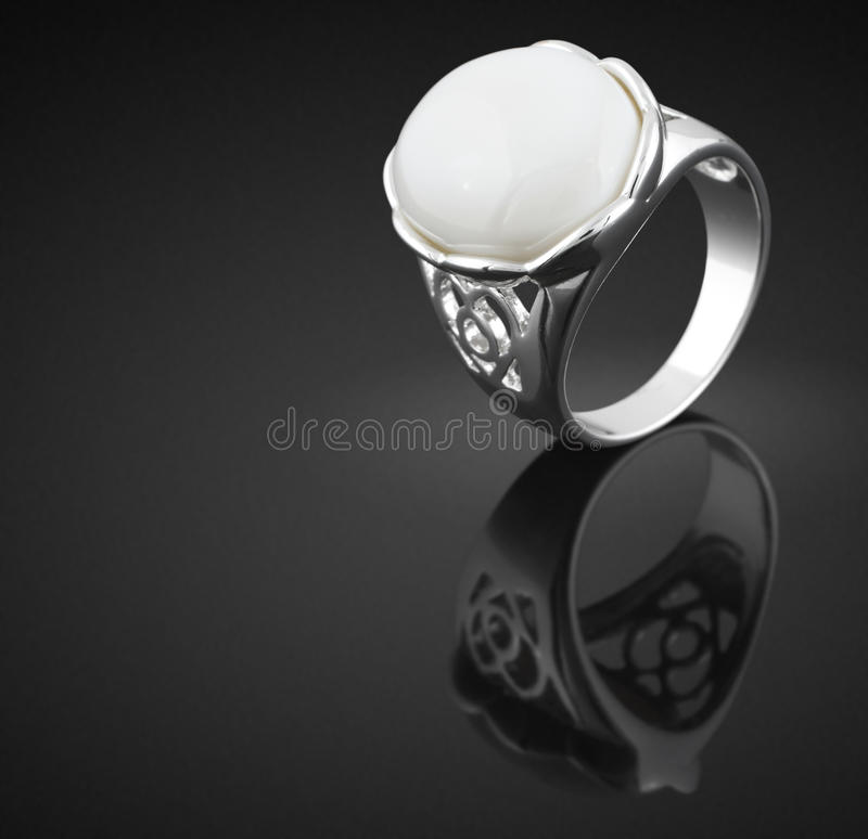 Ring with white gem stock images