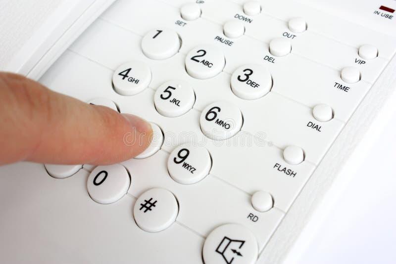 ringande nummertelefon royaltyfri bild