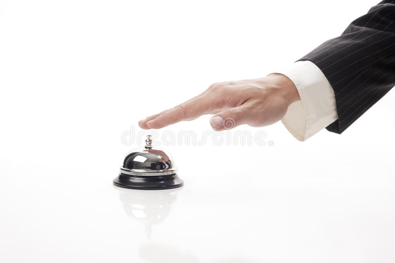 Ringing reception bell. Business man hand ringing the bell to call royalty free stock photos