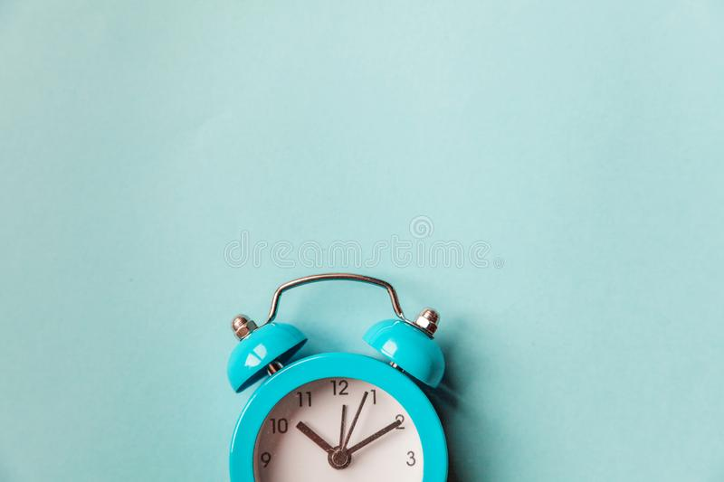 Ringing twin bell vintage classic alarm clock  on blue pastel colorful trendy background. Rest hours time of life good. Morning night wake up awake concept stock images