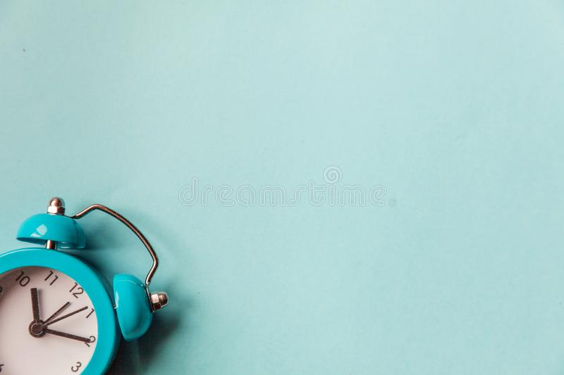 Ringing twin bell vintage classic alarm clock  on blue pastel colorful trendy background. Rest hours time of life good. Morning night wake up awake concept royalty free stock photography