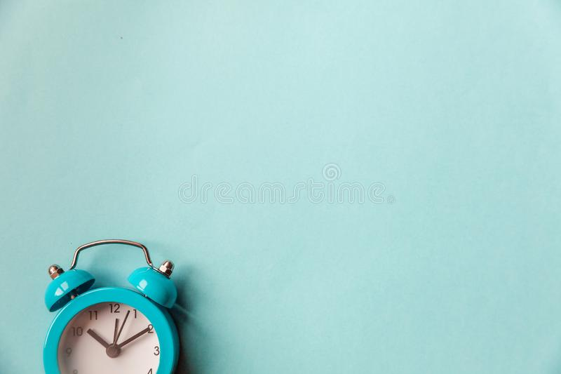 Ringing twin bell vintage classic alarm clock Isolated on blue pastel colorful trendy background. Rest hours time of life good. Morning night wake up awake royalty free stock image