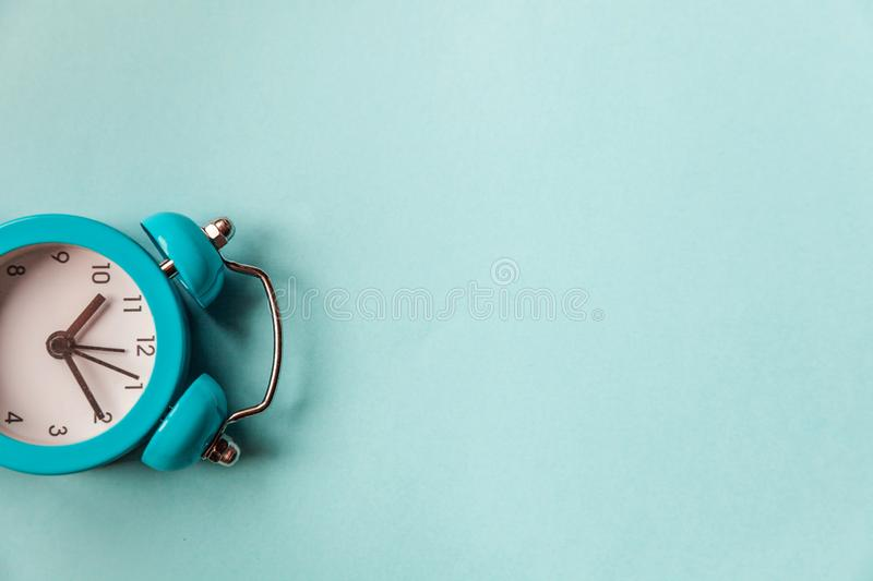 Ringing twin bell vintage classic alarm clock Isolated on blue pastel colorful trendy background. Rest hours time of life good. Morning night wake up awake royalty free stock photo