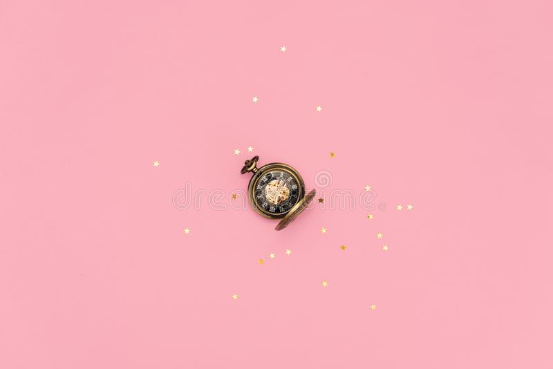 Ringing twin bell vintage classic alarm clock Isolated on pink pastel colorful trendy background. Rest hours time of life good stock images