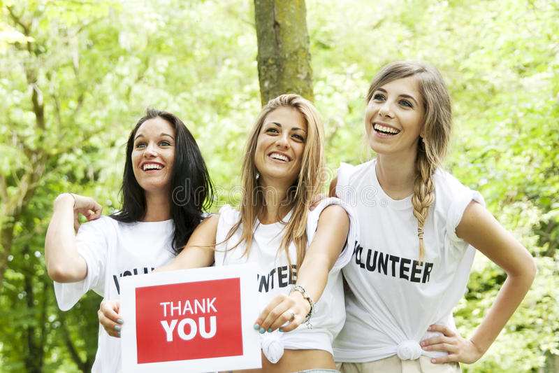 Ringraziamenti dei volontari delle ragazze per le offerte immagine stock libera da diritti