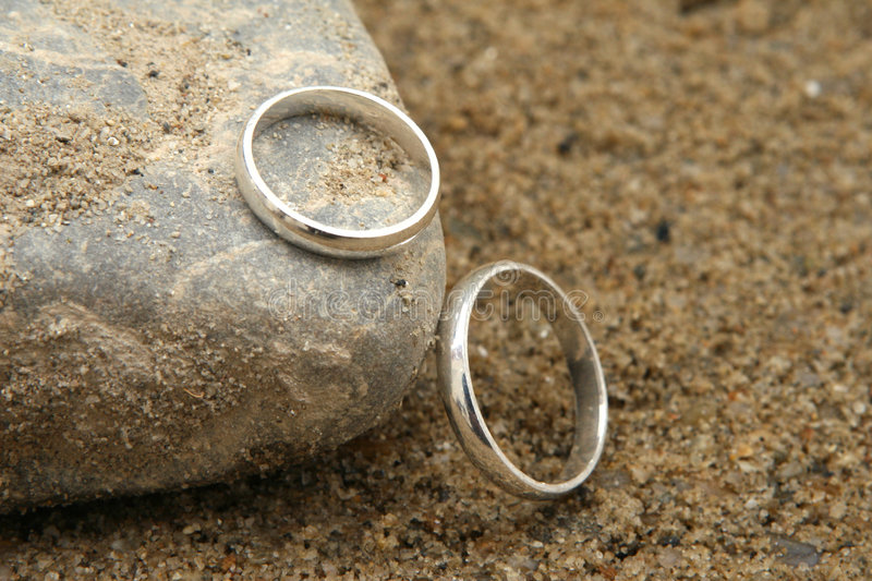 Rings. Two wedding rings on the beach stock photos