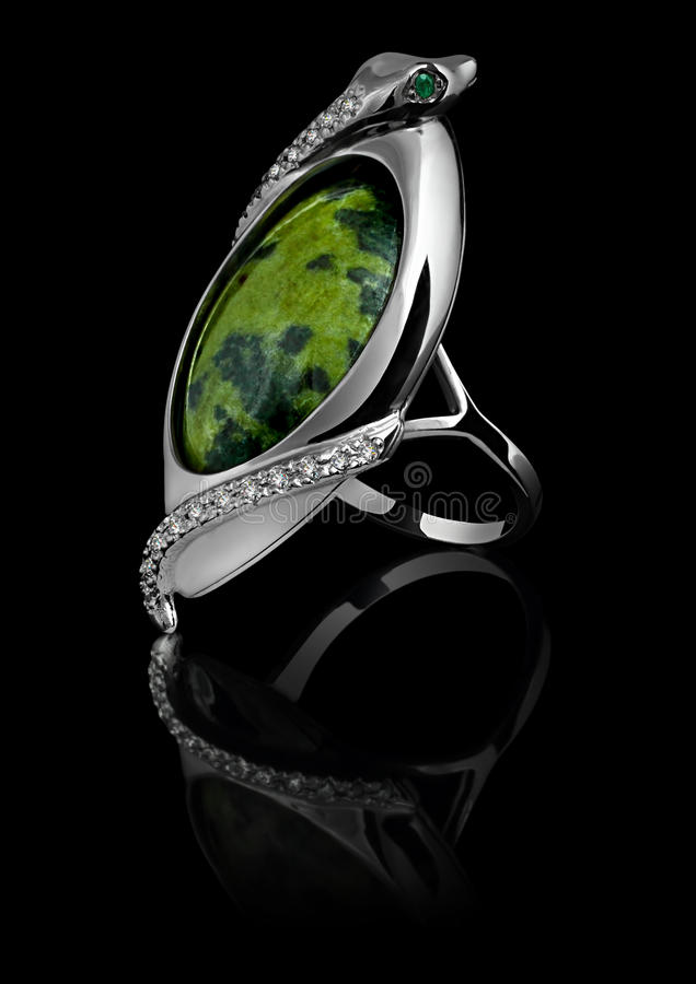 Rings with diamonds and green gem royalty free stock images