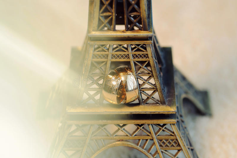 Rings in Eiffel Tower. Closeup of wedding rings in Eiffel Tower stock photos