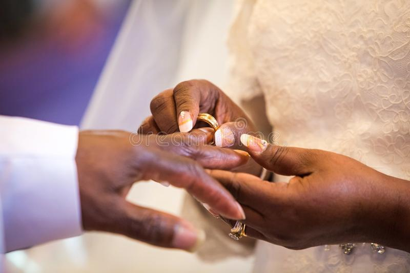 Rings exchange for black couple marriage stock photos