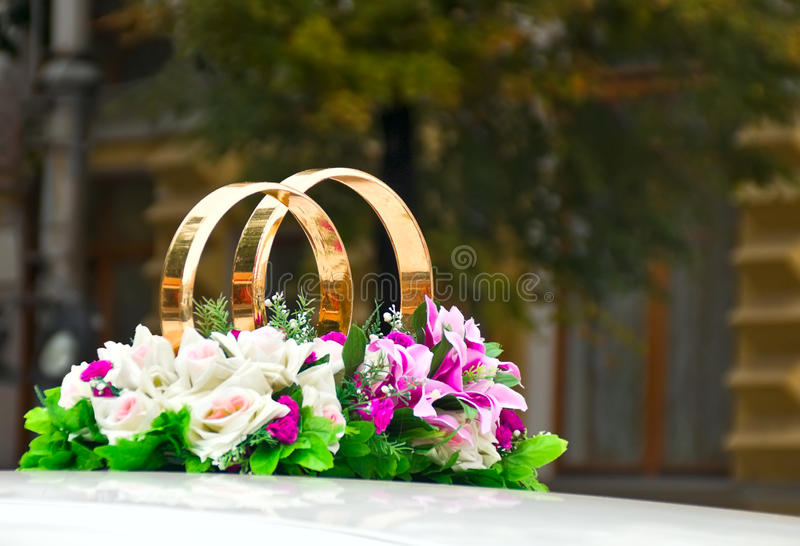 Rings with flowers at wedding. Car stock photo