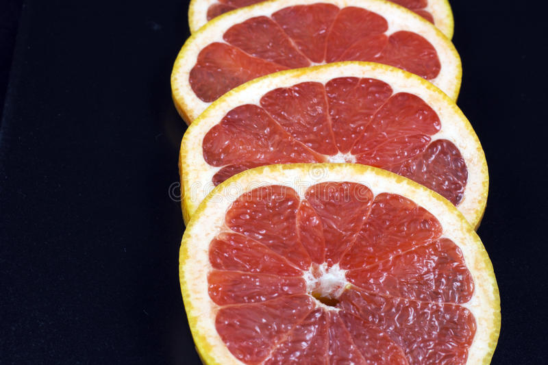 Download Rings of fresh grapefruit stock image. Image of colorful - 83712545