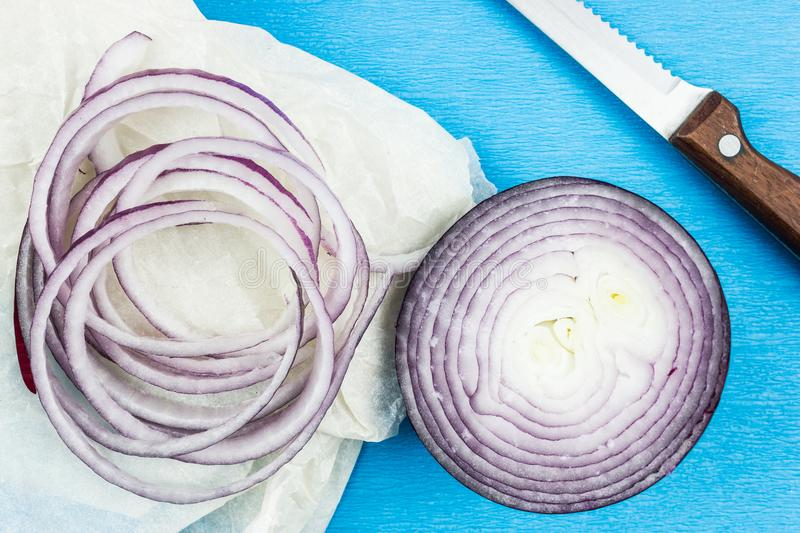 Rings of purple onion and a knife. royalty free stock photo