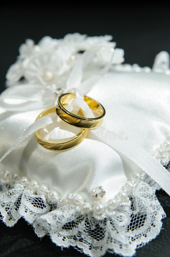 Pair of rings on white cushion. royalty free stock photos