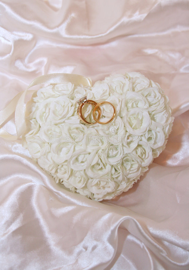Download Rings On Rose Pillow And Satin Stock Photo - Image: 9049956