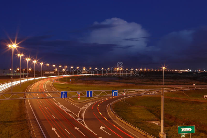 Ringway St Petersburg. Russian road at night, with markings, road signs and lighting masts. royalty free stock images