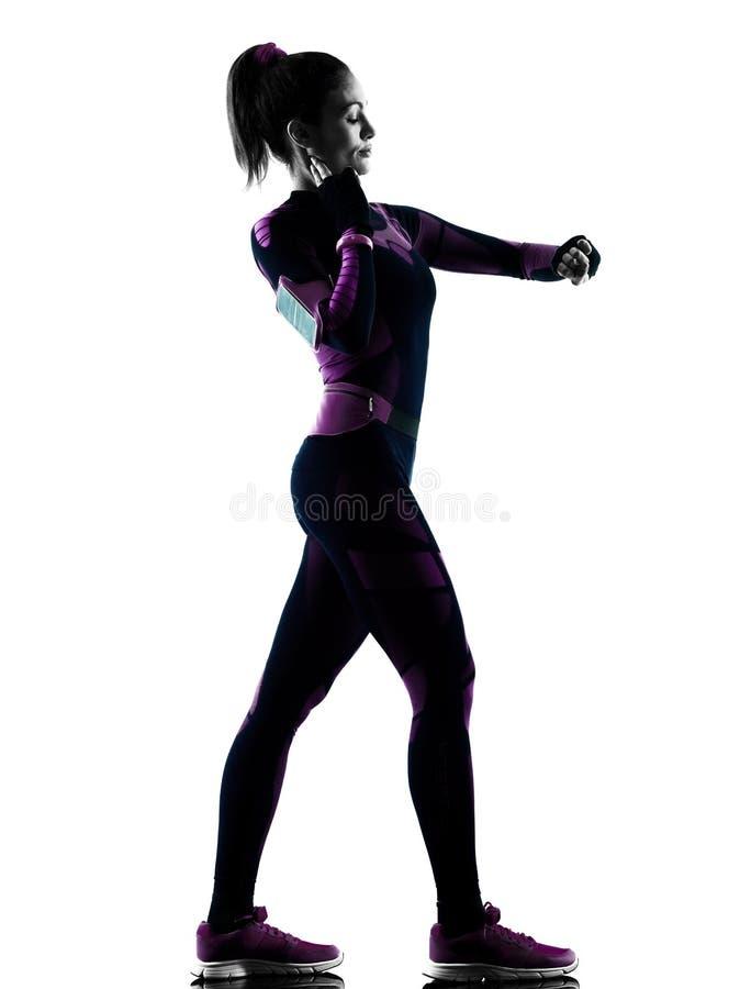 Rinnande jogger för kvinnalöpare som joggar isolerad konturskugga royaltyfri bild