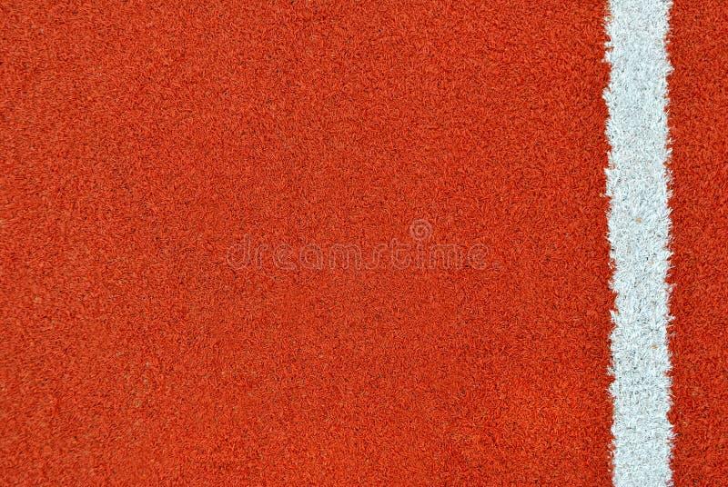 Rinnande spår med den vita linjen textur arkivbild