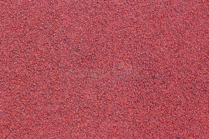 Rinnande spårsporttextur rubber running spår för räkning Tartanspårmaterial är den trademarked allväders- syntetiska spårsuren arkivfoton