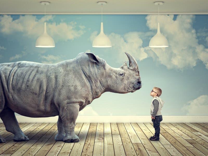 Rinoceronte e criança ilustração stock
