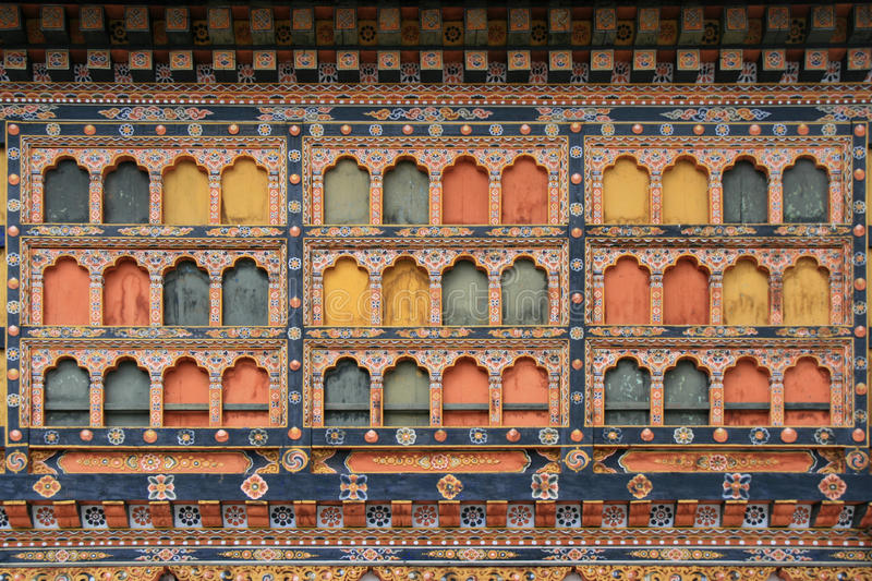 Rinpung Dzong - Paro - Bhutan. Windows of the Rinpung Dzong in Paro, Bhutan, were decorated with painted patterns on 10/14/11. Des fenêtres du Rinpung Dzong stock image