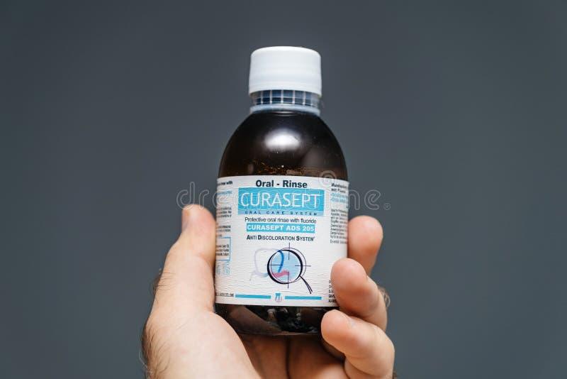 Rinse устного rinse Curasept медицинский зубоврачебный с фторидом стоковая фотография