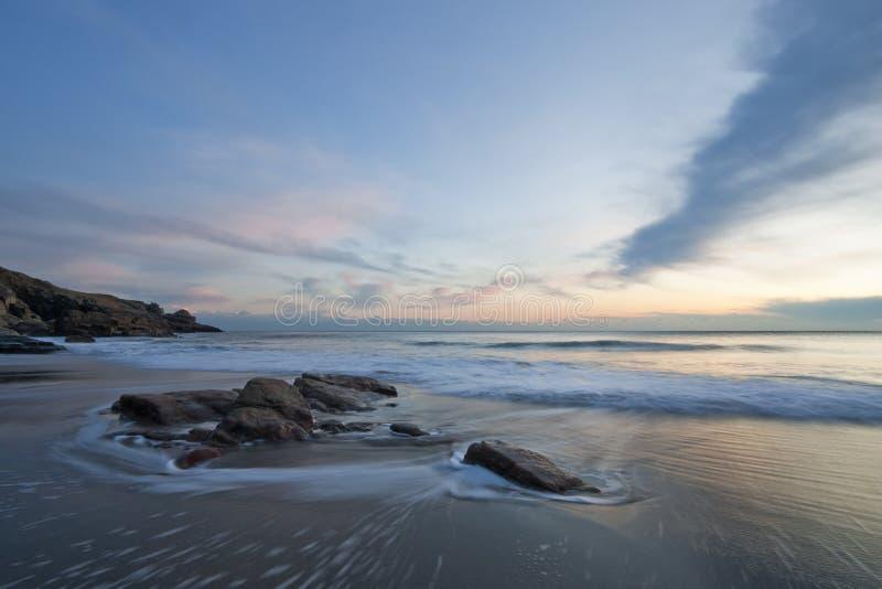 Wave swirling around rocks - Long Exposure royalty free stock photos