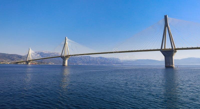 The Rio Antirrio Bridge or Charilaos Trikoupis Bridge, photo taken from the boat during summer holidays 2018. Horizontal stock images