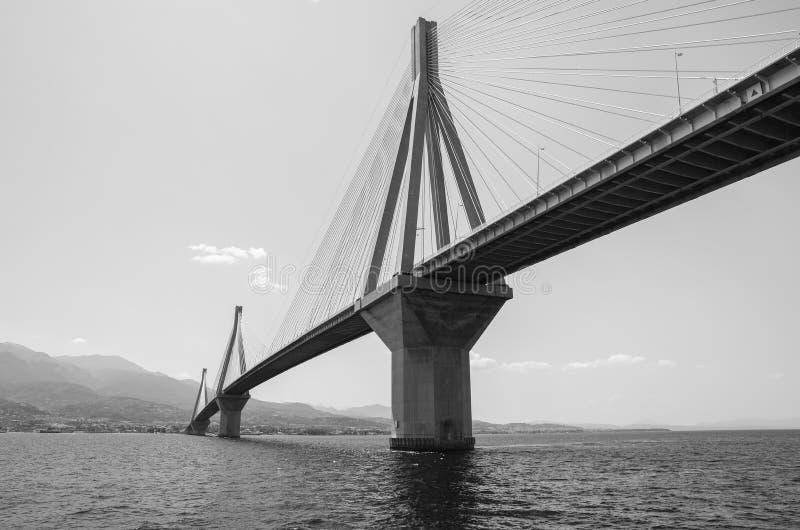 The Rio Antirrio Bridge or Charilaos Trikoupis Bridge, photo taken from the boat during summer holidays 2018. Horizontal. Black and white photography stock photo