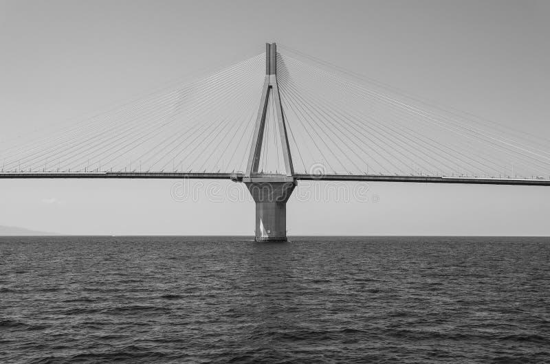 The Rio Antirrio Bridge or Charilaos Trikoupis Bridge, photo taken from the boat during summer holidays 2018. Horizontal. Black and white photography royalty free stock photo