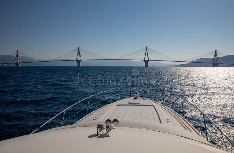 The Rio Antirrio Bridge or Charilaos Trikoupis Bridge, photo taken from the boat in summer morning. Horizontal stock photos