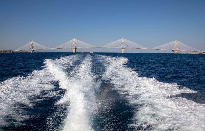 The Rio Antirrio Bridge or Charilaos Trikoupis Bridge, photo taken from the boat in summer morning. Horizontal stock photography
