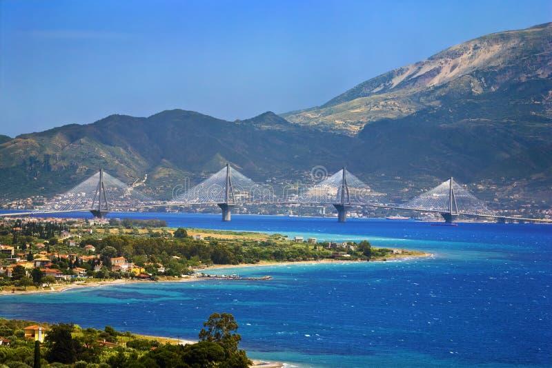 Rio-Antirrio Bridge. Greece. Gulf of Corinth and the Rio-Antirrio Bridge, a cable-stayed bridge linking the town of Antirrio (mainland Greece, foreground) to Rio stock photography