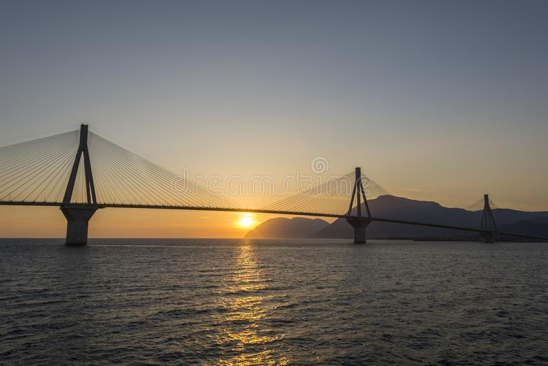 Rio antirrio suspended bridge in Greece. Rio antirrio suspended bridge at sunset in Greece royalty free stock photography