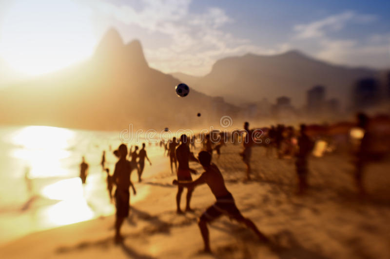 Rio Brazil Beach Football Brazilians Playing Altinho. Rio de Janeiro Brazil beach football silhouettes of Brazilians playing keepy uppy altinho soccer on the royalty free stock images