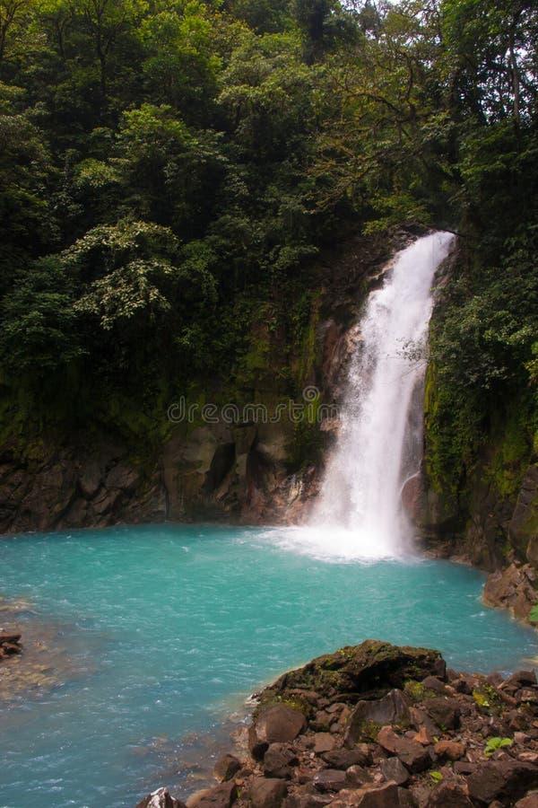 Rio Celeste River Waterfall fotografering för bildbyråer