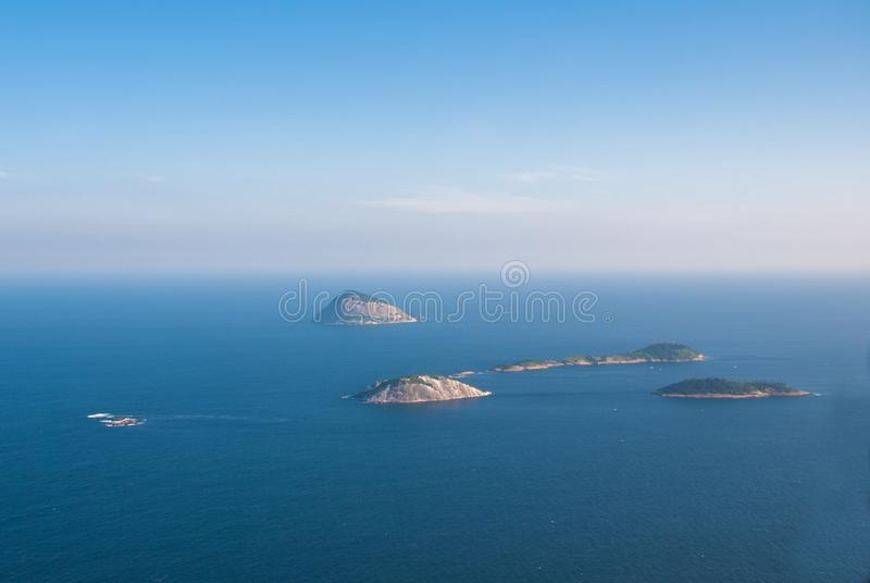 Rio de Janeiro, Brazil: Aerial view of an ocean surrounded by a complex of hills, islands and mountains. Rio de Janeiro, Brazil, America: Aerial view of an ocean stock photography
