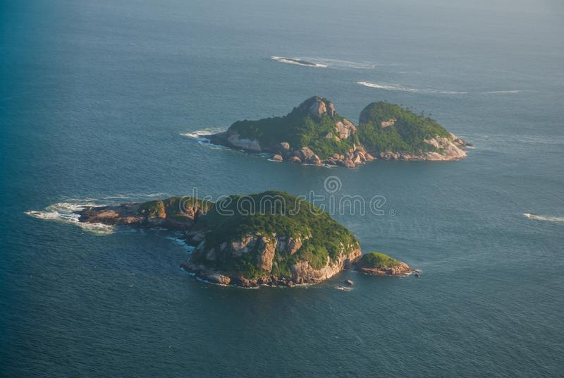 Rio de Janeiro, Brazil: Aerial view of an ocean surrounded by a complex of hills, islands and mountains. Rio de Janeiro, Brazil, America: Aerial view of an ocean stock photo