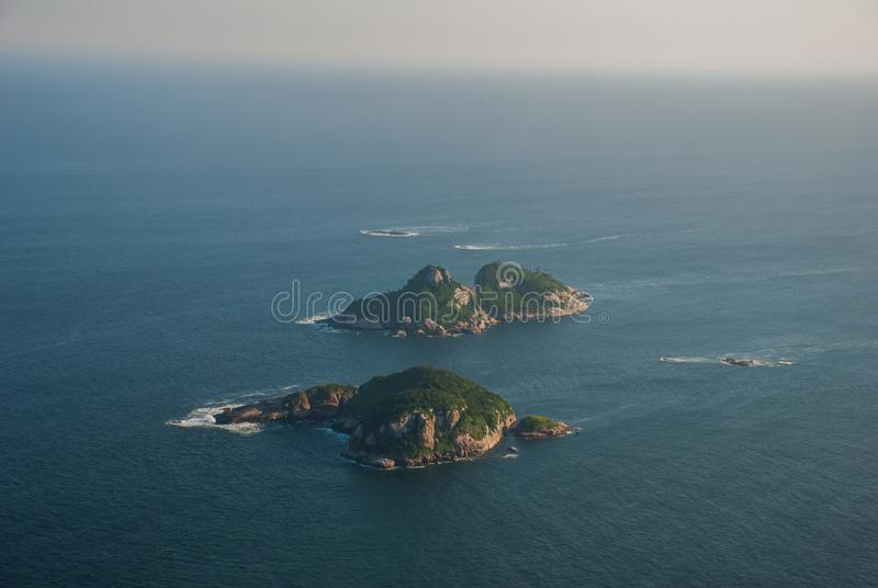 Rio de Janeiro, Brazil: Aerial view of an ocean surrounded by a complex of hills, islands and mountains. Rio de Janeiro, Brazil, America: Aerial view of an ocean stock photos