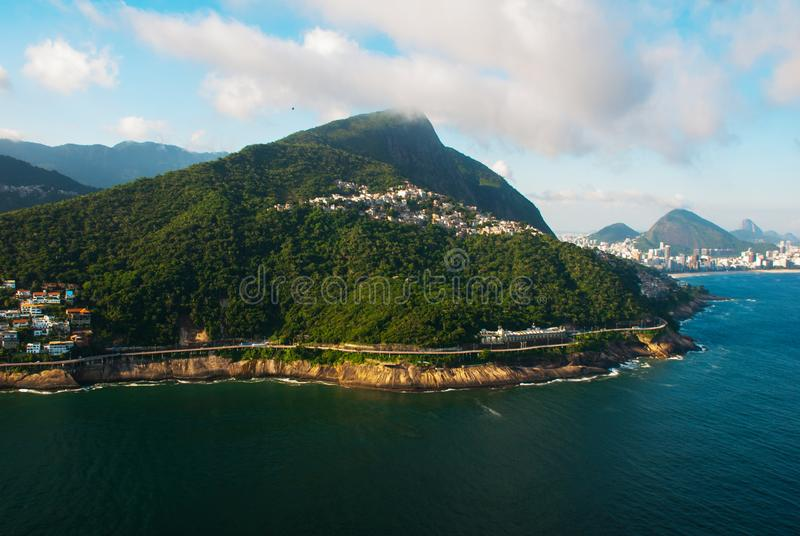 Rio de Janeiro, Brazil: Aerial view of an ocean surrounded by a complex of hills, islands and mountains with native forests and. Rio de Janeiro, Brazil. Aerial stock image