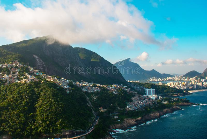 Rio de Janeiro, Brazil: Aerial view of an ocean surrounded by a complex of hills, islands and mountains with native forests and. Rio de Janeiro, Brazil. Aerial royalty free stock photo