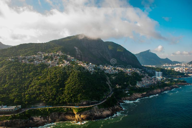 Rio de Janeiro, Brazil: Aerial view of an ocean surrounded by a complex of hills, islands and mountains with native forests and. Rio de Janeiro, Brazil. Aerial royalty free stock images