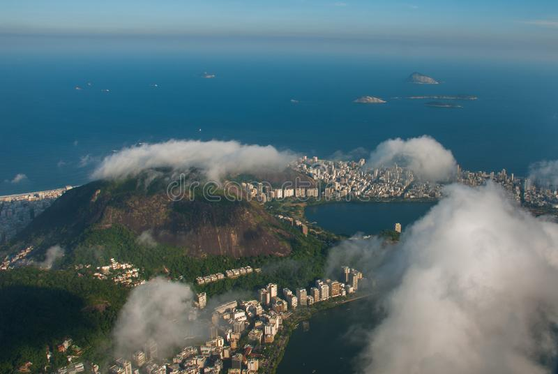 Rio de Janeiro, Brazil: Aerial view of an ocean surrounded by a complex of hills, islands and mountains with native forests and. Rio de Janeiro, Brazil. Aerial stock photography