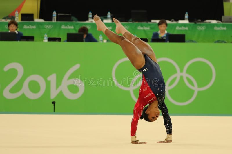 Olympic champion Gabby Douglas of United States competes on the floor exercise during women`s all-around gymnastics qualification. RIO DE JANEIRO, BRAZIL stock images