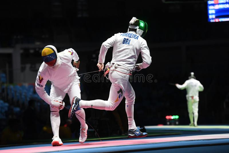 Fencing competition. Rio de Janeiro - Brazil  Fencing competition during the 2016 Olympic Games royalty free stock image