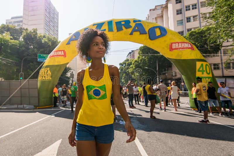 Young Brazilian Female Football Fan. Rio de Janeiro, Brazil - June 22, 2018: Young Brazilian woman is coming to support national football team during 2018 FIFA royalty free stock photography