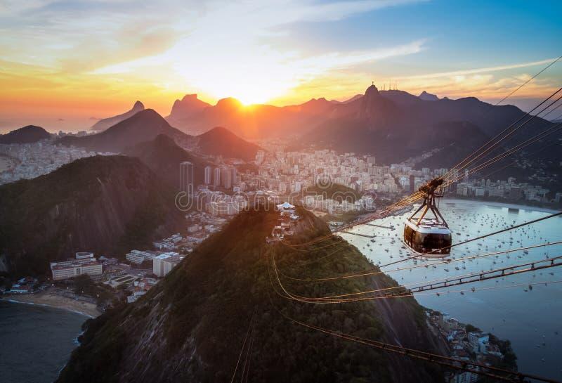 Aerial view of Rio de Janeiro at sunset with Urca and Sugar Loaf Cable Car and Corcovado mountain - Rio de Janeiro, Brazil royalty free stock photos