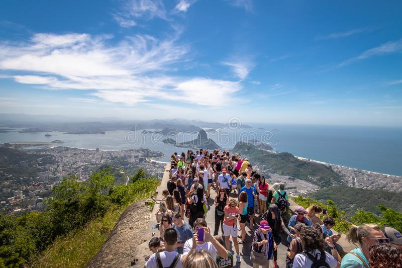 Tourists at Christ the Redeemer Statue with an aerial view of Guanabara Bay and Sugar Loaf Mountain - Rio de Janeiro, Brazil royalty free stock images