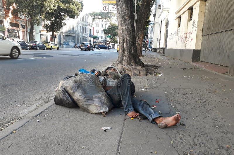 Homeless sleeping. Rio de Janeiro, Brazil, September 3, 2018.nHomeless sleeping on the sidewalk of Freia Caneca street in downtown Rio de Janeiro royalty free stock photos