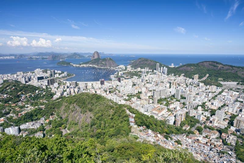 Rio de Janeiro Brazil Skyline Bright Scenic Overlook. Bright scenic overlook of Rio de Janeiro city skyline with Sugarloaf Mountain, Botafogo, Guanabara Bay and stock photo