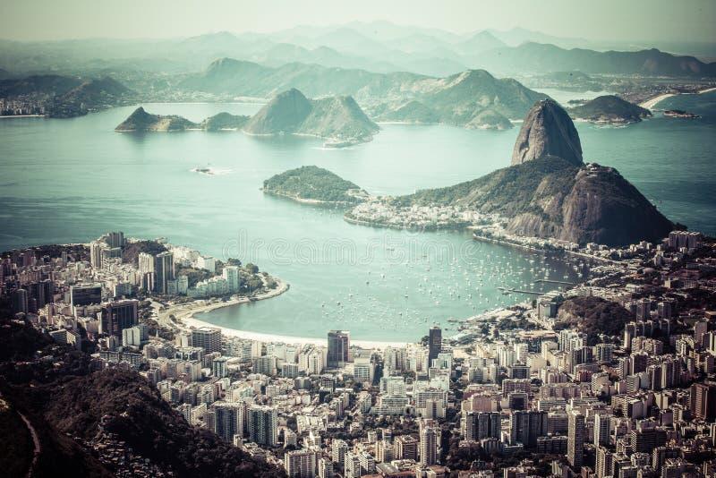 Rio de Janeiro, Brazil. Suggar Loaf and Botafogo beach viewed from Corcovado.  stock photos